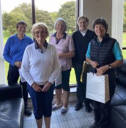The lady captain plus the various winners on the day