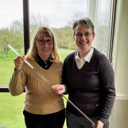 Kath Stavers presents Dawn Coburn with the charity putter