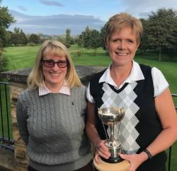 Debbie with the lady captain's away day trophy