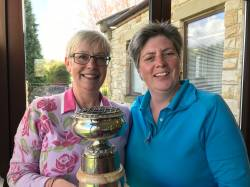 Linda receiving her trophy from the Lady Captain
