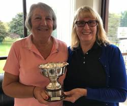 Maureen Rook receiving the trophy from the lady captain, Kath Stavers
