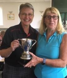 Dawn receiving the trophy from the lady captain